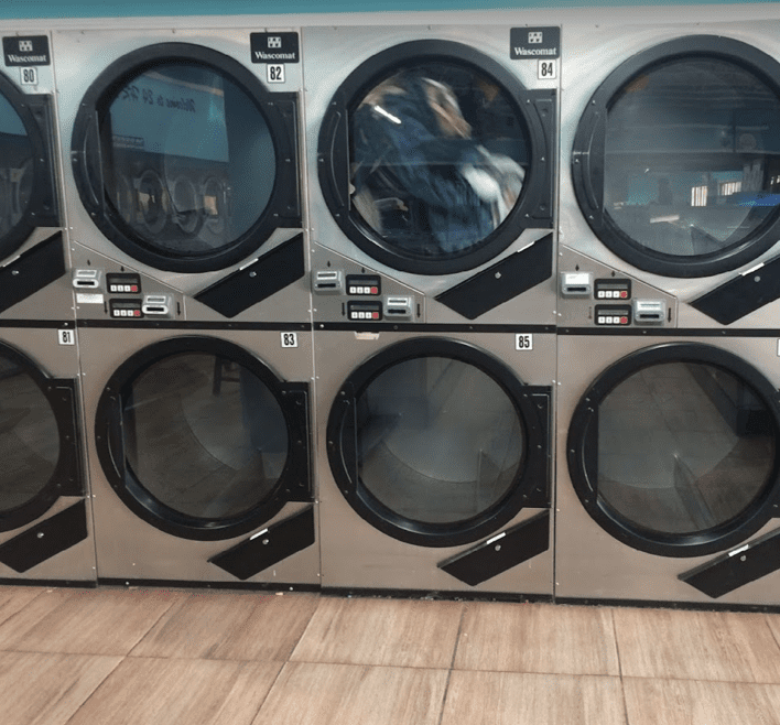 24 Hour Laundry dryers in the washateria drying laundry for their family