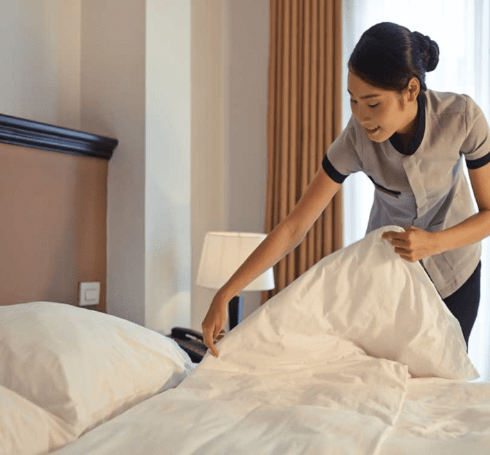 24 Hour Laundry's commercial laundry services enable hotel worker to add clean linen, sheets, pillowcases, comforters, towels, and napkins in hotel room