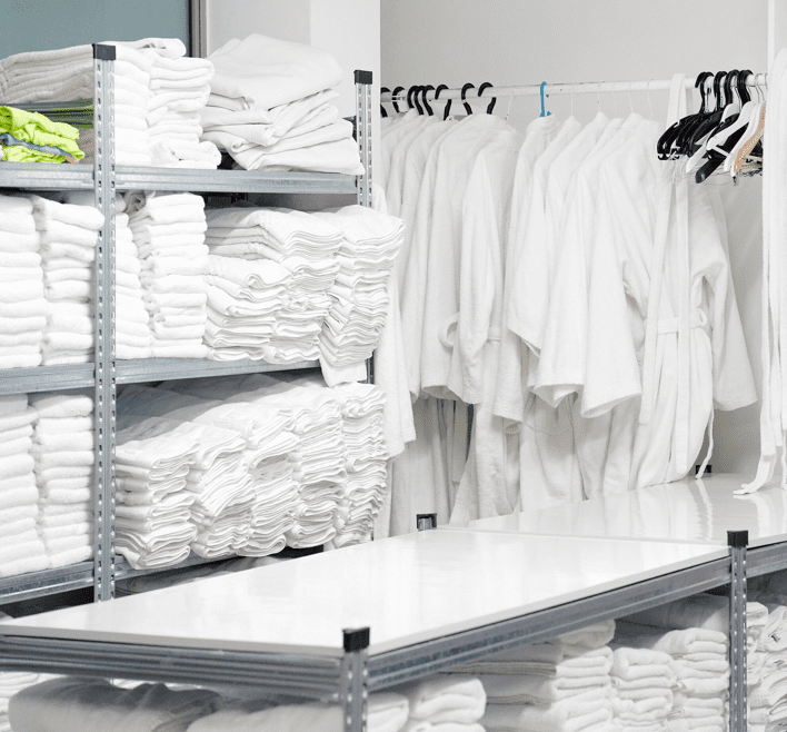 Laundry towels, linens, and robes are in a laundry storage room