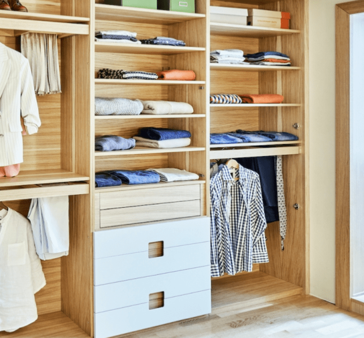 Wash and fold laundry from 24 hour laundry placed in beautiful luxury designer closet